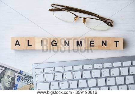 Modern Business Buzzword - Alignment. Top View On Wooden Table With Blocks. Top View. Close Up.