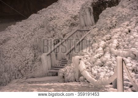 Completely Frozen Stairs With Thick Icicles Near Seljalandsfoss Waterfall In Icelan, Europe.