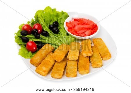 Fried fish sticks with vegetables. Isolated on white.
