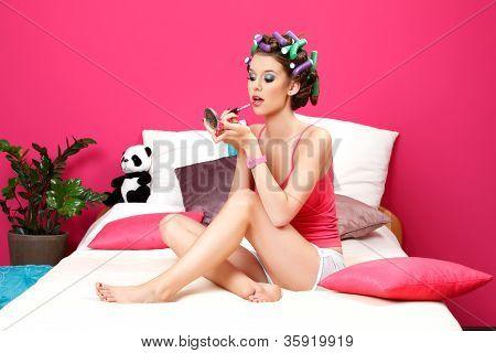 Teenager Applying Pink Lipstick
