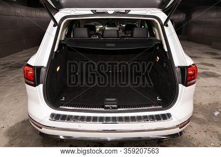 Novosibirsk, Russia - February 09 , 2020 Volkswagen Touareg, Close-up Of The Open Trunk, Headlight,