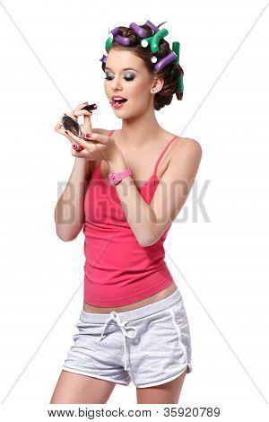 Cute Teenager Girl Applying Lipstick