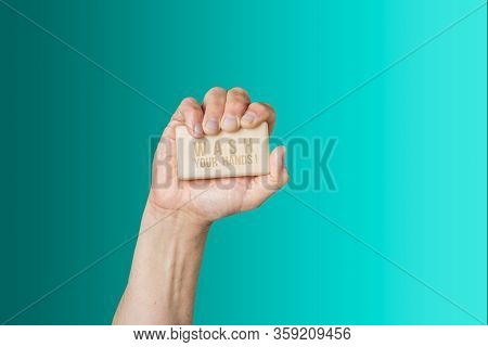 Caucasian Male Hand Holding Bar Of Soap With Message Wash Your Hands