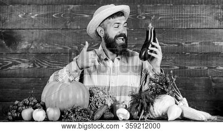 Homegrown Organic Food. Man With Beard Wooden Background. Organic Horticulture Concept. Farmer With