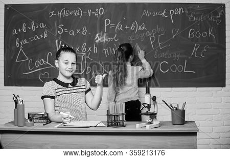 Science Is My Life. Little Scientist Work With Microscope. Little Girls In School Lab. Chemistry Edu