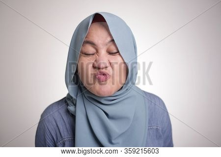 Portrait Of Funny Young Asian Muslim Woman Making Silly Face Isolated On White