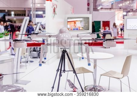 Belarus, Minsk, 25 May 2019.quadrocopter White Model At A Technology Exhibition