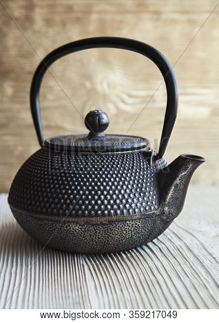 Close Up Black Metall Tea Pot On A Wooden Background