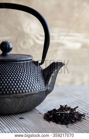 Tea And  Black Metall Tea Pot On A Wooden Background