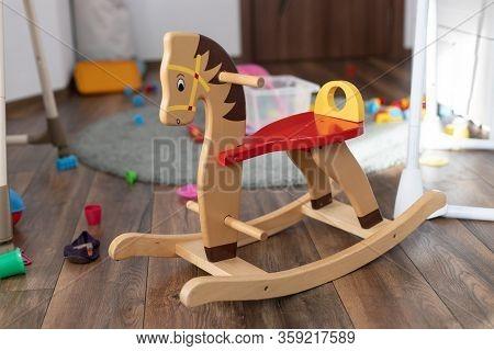 Wooden Rocking Horse. Children Toy In Messy Children's Room