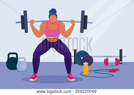 Woman Exercising With Barbell. Woman With Muscular Body Lifts A Barbell On The Shoulders And Does Sq