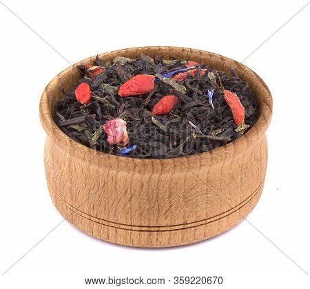 Dried Black Tea With Slices Of Dried Cherry, Safflower Petals In A Wooden Bowl, Delicious, Natural,