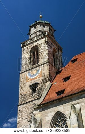 DINKELSBUHL, GERMANY - JULY 16, 2006: St.-Georgs-Kirche church tower with blue sky