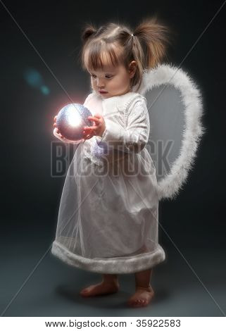 Little Girl Holding Christmas Ornament
