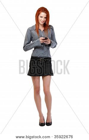 Redhead Woman Reading Short Message On Her Cellphone