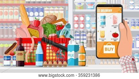 Hand Holding Smartphone With Shopping App. Grocery Store Delivery. Internet Order. Online Supermaket