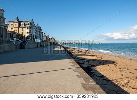 St Malo, France - September 14, 2018: People Walking Along Promenade At Seafront In Saint Malo, Brit