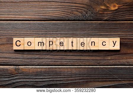 Competency Word Written On Wood Block. Competency Text On Table, Concept
