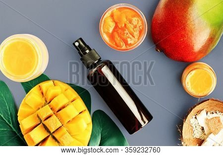 Summer Spa Skincare With Fresh Tropical Fruit Ingredient, Top View Blue Backgound. Mango Facial Mask