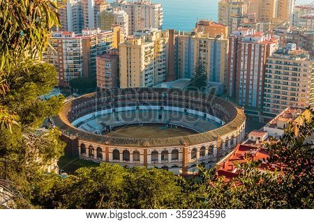 Historic Bullring In Malaga From Above. In The Center Between High-rise Buildings With A View Over T