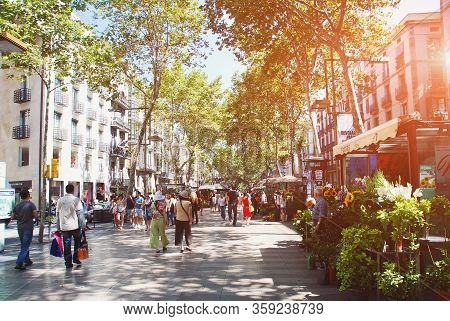 07.2012, Barcelona, Spain: The Rambla Pedestrian Boulevard Is Full Of Tourists From All Countries, F