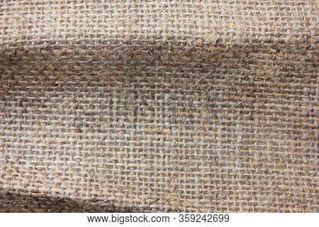 Burlap Hessian Fabric Texture Sackcloth Background. Brown Coarse Fabric Texture Made Of Hemp Or Jute