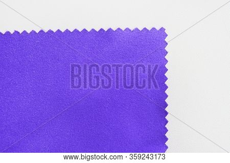 Blue Fabric Texture Swatch Piece Isolated On White Background. Top View Of Cut Velvet Blue Material