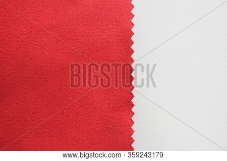 Dark Red Fabric Texture Swatch Detail Isolated On White Background. Piece Of Smooth Burgundy Colour