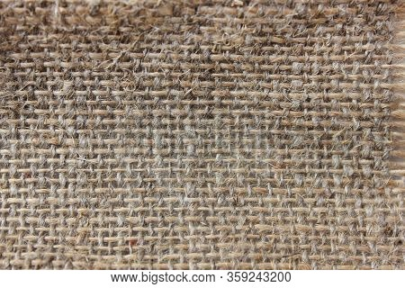 Burlap Hessian Fabric Texture Sackcloth Background. Brown Coarse Fabric Texture Made Of Hemp Or Jute