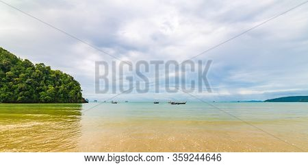 Beautiful Beach At Ao Nang, Krabi Thailand. View Of Pure Blue Water With Long Tailed Boats Prepared