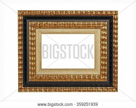 Empty Black Beige Wooden Frame For Paintings With Gold Patina. Isolated On White Background