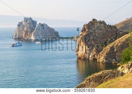 The Rocky Coast Of Olkhon Island And Cape Burhan On A Summer Evening In The Rays Of The Setting Sun.