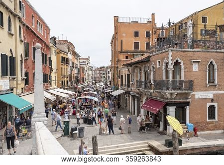 Venice, Italy - June 29 2017: A View Of The Small Streets Of Venice, The Colorful Venetian Houses Wi