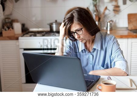 Upset Woman Working From Home Office. Worry Freelancer Using Laptop And The Internet. Workplace In C