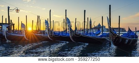 Gondolas At Sunrise In Venice, Italy, Europe