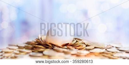 Coins In Sack And Plant Glowing In Savings Money, Passive Income, Pension And Retirement Concept. In
