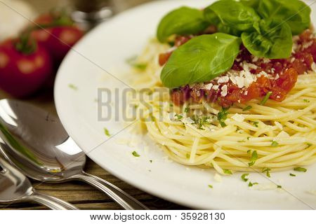 Delicious Fresh Spaghetti With Tomato Sauce And Parmesan On Table