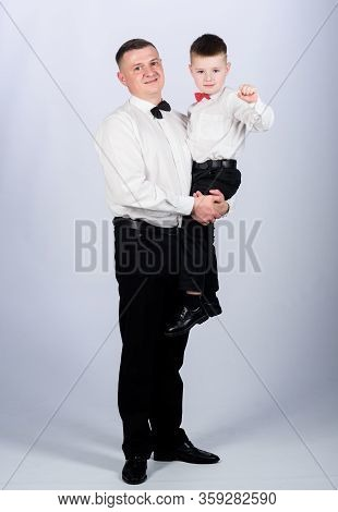 Gentleman Upbringing. Father Carry Hug Son Formal Clothes Outfit. Grow Up Gentleman. Gentleman Upbri