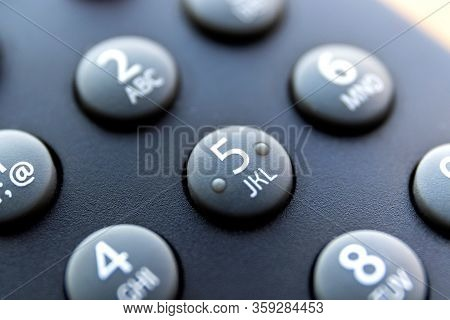 A Close Up Portrait Of The Numeric Buttons Of A Television Remote Control. The Button With Number 5