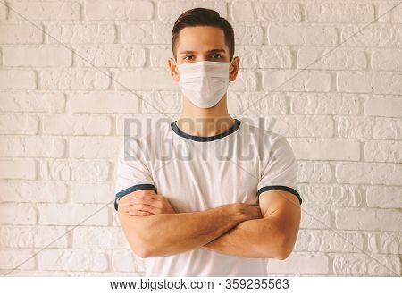 Portrait Young Confident Man Wearing Face Mask For Protection Against Chinese Coronavirus Covid-19.