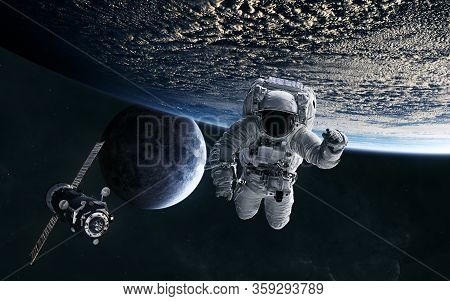 Astronaut, Iss In Low Earth Orbit. Moon. Solar System. Science Fiction. Elements Of This Image Furni