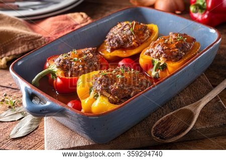 Delicious Homemade Stuffed Peppers In Savory Tomato Sauce.