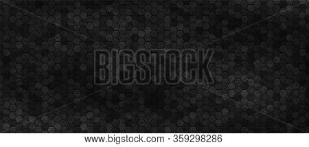 Black Wall With Hexagon Tiling. Dark Background With Carbon Hexagonal Tiles Or Polygonal Cells. Abst