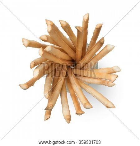 Italian breadsticks in a glass isolated on white background seen from above
