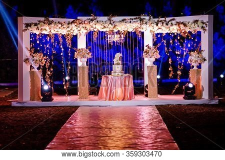 Image Of A Beautiful Wedding Cake At Wedding Reception. Wedding Cake At Evening Ceremony