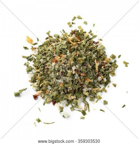 Heap of sel de Camargue mixed with dried herbs isolated on white background