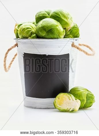 Bowl With Raw, Fresh, Whole And Cut Brussels Sprouts (cabbages - Brassica Oleracea). Copy Space. Iso