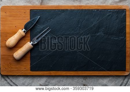 Empty Table For Cheeses And Other Openings. Copyspace (copy Space) Blackboard Fork And Knife For Che