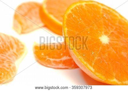Half Orange With Lobules Isolated On White Background