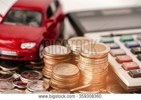Car On Coins Background : Car Loan, Finance, Saving Money, Insurance And Leasing Time Concepts.